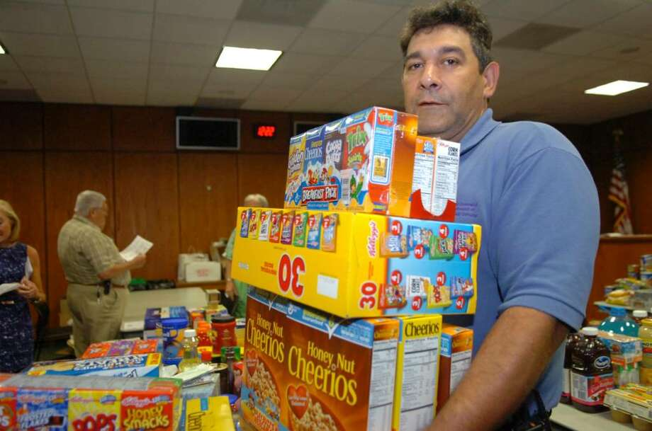 Louis Borselio, of Riverside, who works in the Greenwich parking services department, donated food during to the Salvation Army's Greenwich Town Hall employee food drive, on Thursday, July 22, 2010. Photo: Helen Neafsey / Greenwich Time