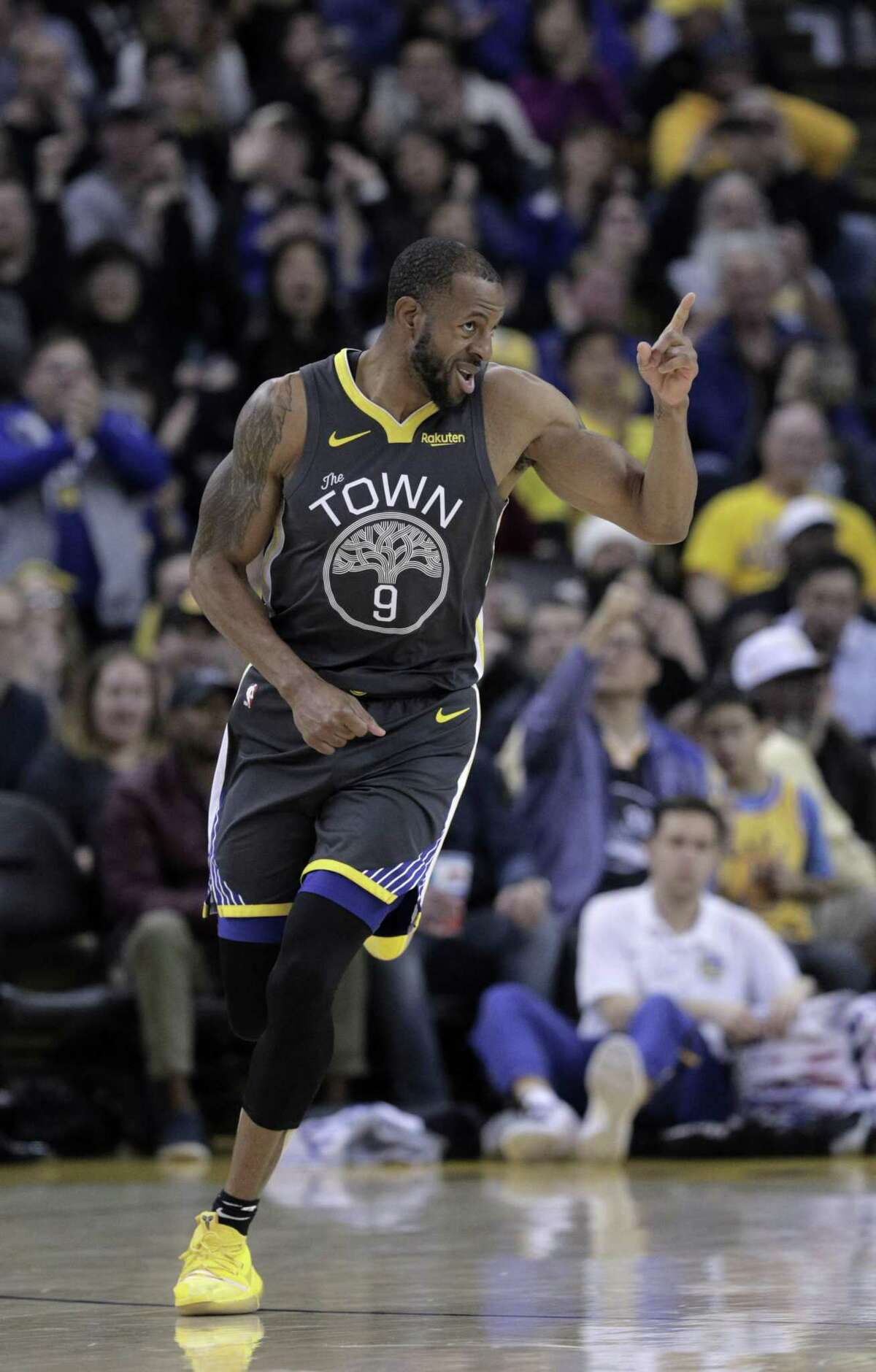 Andre Iguodala (9) gestures after dunking a shot in the first half as the Golden State Warriors played the San Antonio Spurs at Oracle Arena in Oakland, Calif., on Wednesday, February 6, 2019.