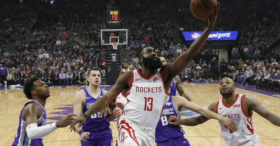 Houston Rockets guard James Harden, center goes to the basket against Sacramento Kings' Buddy Hield, left, and others during the first quarter of an NBA basketball game Wednesday, Feb. 6, 2019, in Sacramento, Calif. (AP Photo/Rich Pedroncelli) Photo: Rich Pedroncelli/Associated Press