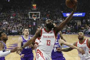 Houston Rockets guard James Harden, center goes to the basket against Sacramento Kings' Buddy Hield, left, and others during the first quarter of an NBA basketball game Wednesday, Feb. 6, 2019, in Sacramento, Calif. (AP Photo/Rich Pedroncelli)