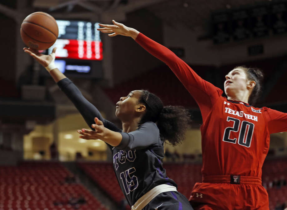 Texas Tech junior forward Brittany Brewer goes up to block a shot attempt by TCU junior guard Jayde Woods during Big 12 Conference women's basketball action on Wednesday night at United Supermarkets Arena in Lubbock. TCU won, 70-63. Photo: Brad Tollefson/Lubbock Avalanche-Journal