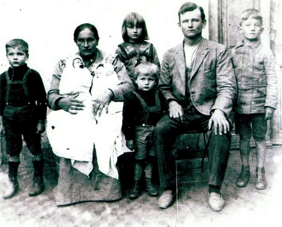 This is Henry and Wanda Kern and their family, taken when they began their journey from Uruguay in South America to Fairgrove, Michigan in July 1920. From left are Henry Jr., his mother Wanda holding the 1-month-old twins Elsie and Mary, Tillie in the back with Rudy in front of her, Henry Sr. and Ted standing beside his dad.