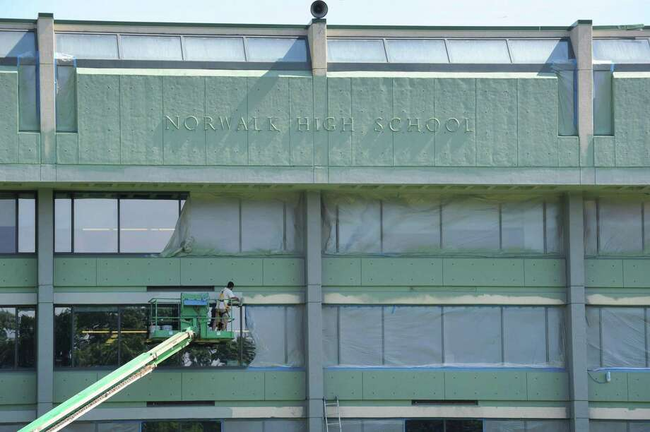 Norwalk High School gets a fresh coat of paint in August. Photo: Erik Trautmann / Hearst Connecticut Media / Norwalk Hour