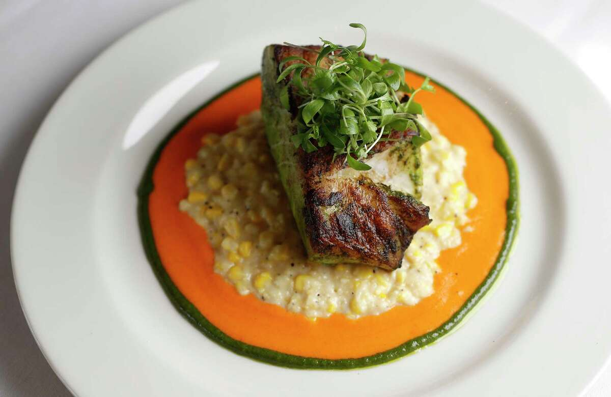 Pan-seared sea bass, served with creamy corn and red pepper coulis at the new Perry's Steakhouse & Grille River Oaks.