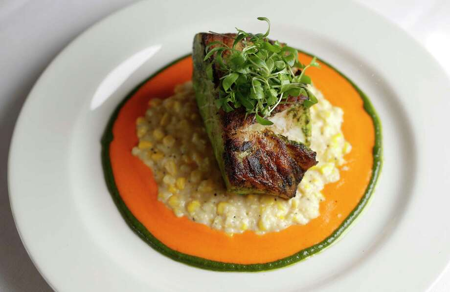 Pan-seared sea bass, served with creamy corn and red pepper coulis at the new  Perry's Steakhouse & Grille River Oaks. Photo: Karen Warren, Staff Photographer / © 2019 Houston Chronicle