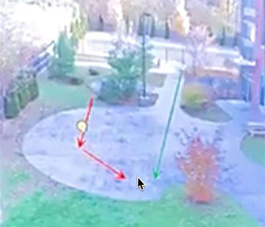 According to Albany County District Attorney David Soares' office, Detective James Olsen ran on a straight line, shown in green, while Williams cut to the right then weaved back to the left, in the direction that Olsen was running. He tripped on the pavement and stumbled to the ground. He quickly got back up and was starting to run again when Olsen fired two shots from about 15 feet away, striking him once. (Screenshot from Times Union Facebook live video)