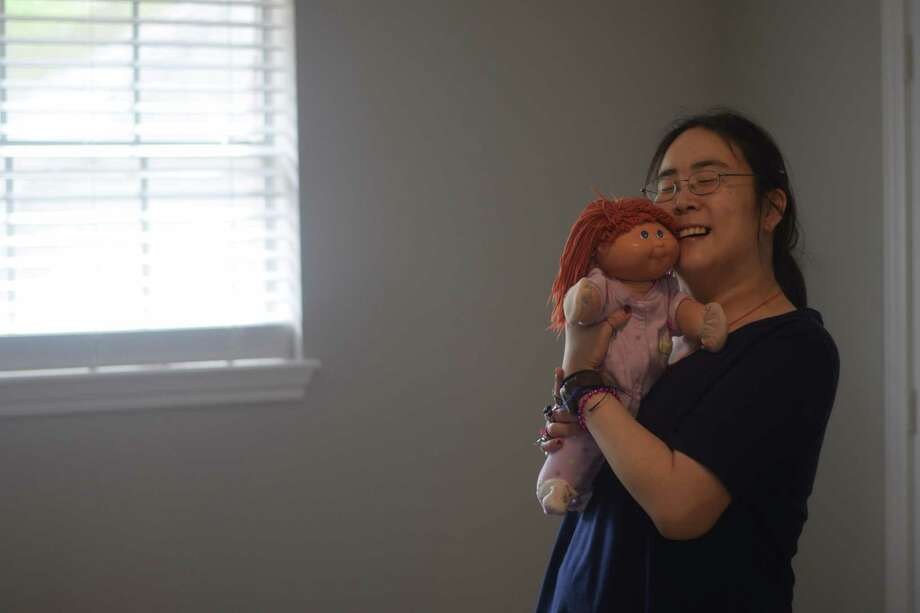 Joanna Chen lives in the Reach Unlimited Group Home in her own, separate apartment in the house, with her own living space, bedroom and dolls she has had since childhood. Photo: Chevall Pryce