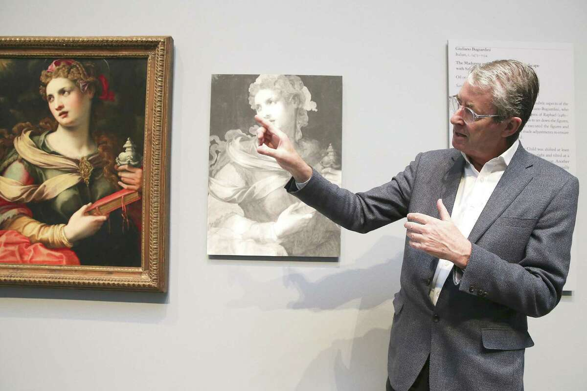 """MFAH curator David Bomford talks about Michele Tosini's """"Saint Mary Magdalene"""" in front of an infrared image of the painting in the 2018 exhibition """"Hidden Layers."""""""