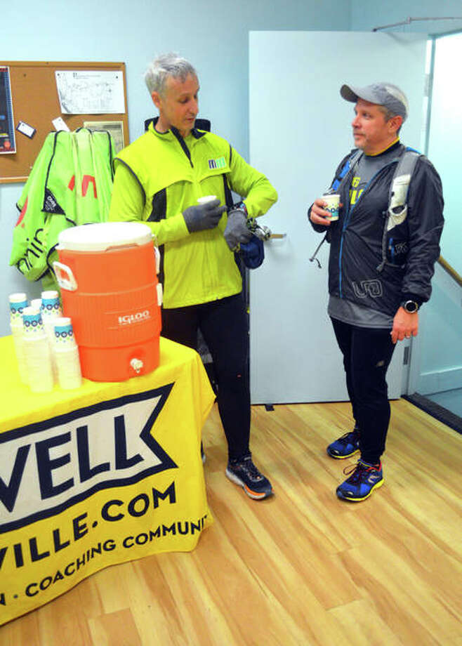 Jay Hunt, left, of Edwardsville, and Larry McCracken, of Collinsville, take a water break and compare their times on Wednesday night during the fifth annual Chilly Chili Run & Cook-Off, which is part of the February Sucks Running Series at Runwell, 142 N. Main St. in Edwardsville. Runwell hosts group runs every Wednesday at 6:30 p.m. and every Saturday at 8 a.m. The runs are free to the public. Photo: Scott Marion | The Intelligencer