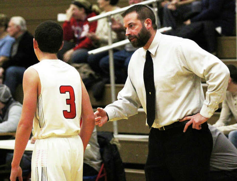 Callhoun coach Ryan Graner (right) talks to Drew Baalman during a game at the Carlinville Tourney on Dec. 26. On Wednesday night in Hardin, Baalman scored 33 points in a win over Gillespie. Photo: Greg Shashack / The Telegraph