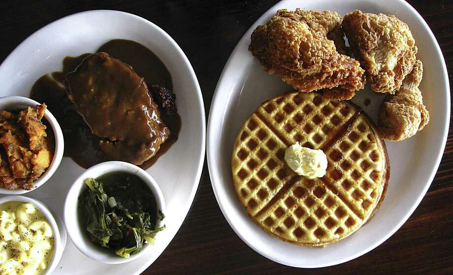 Meatloaf with gravy and sides of candied yams, greens and mac and cheese and the Number One chicken and waffles plate with a wing, a thigh, a breast and two waffles from Mr. C's Fried Chicken & Waffles. Photo: Mike Sutter /Staff
