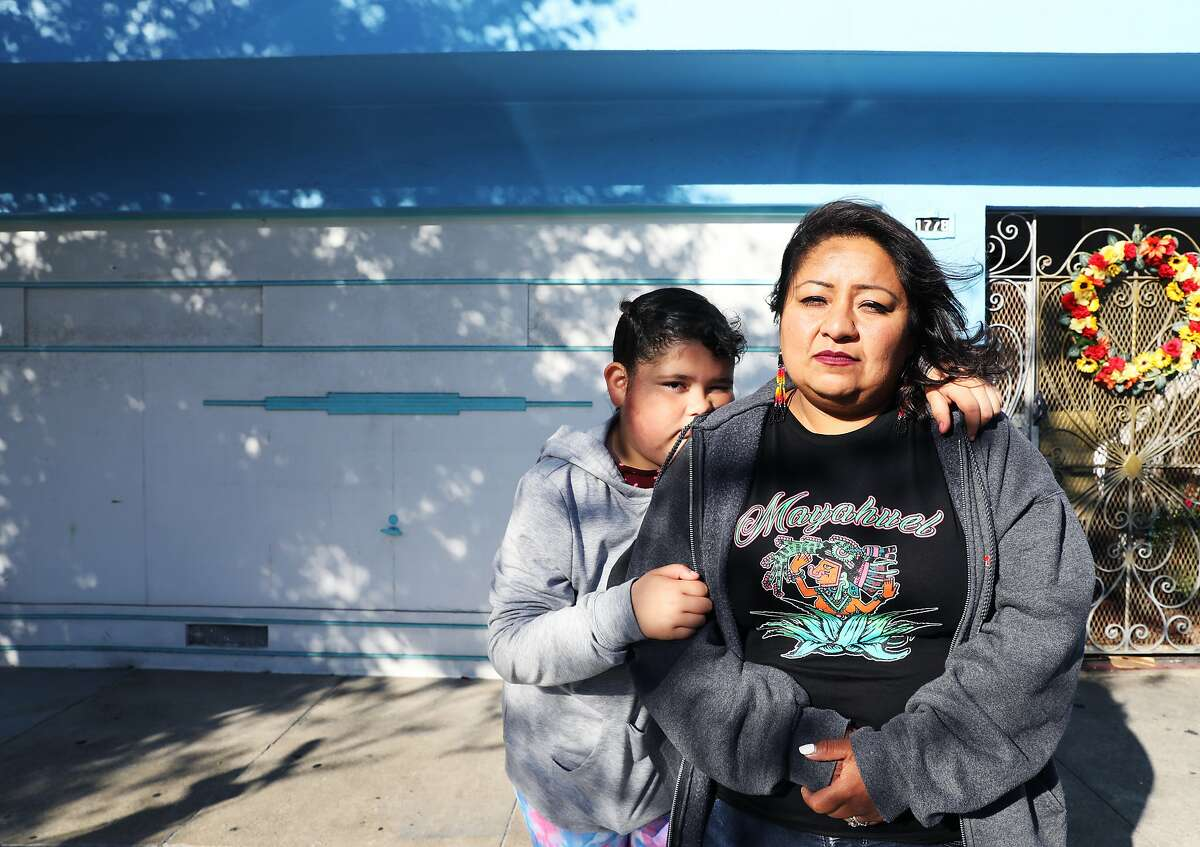 """Alyssa Tello, 10, and her mother, Reina Tello, 36, pose for a portrait in front of their former home at 1778 Newcomb Ave., in the Bayview District, in San Francisco, Calif., on Saturday, September 22, 2018. The Tellos were evicted from their home two days prior. """"They came in and started yelling, 'Sheriff's department, sheriff's department,'"""" Alyssa recounted. """"They didn't ring the doorbell. They didn't do many things they were supposed to do. They came in like they were ready for war."""" For the time being, the Tellos, which also includes Alyssa's sister, Marisol Tello, 6, maternal grandmother, Juana Ines Tello, 70, and aunt, Juana Tello, 32, are staying with a relative until they can find housing."""