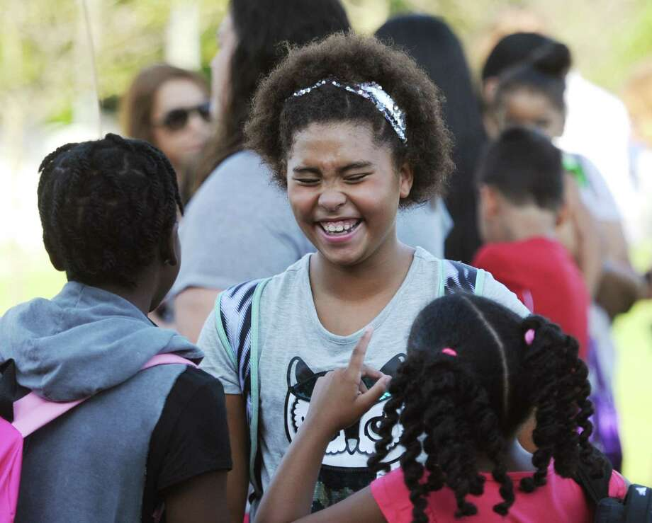 Mia Hickman chats with other students before the annual Parade of Students on the first day of school at Hamilton Avenue School in the Chickahominy section of Greenwich, Conn. Thursday, Aug. 30, 2018. As an icebreaker to welcome the kids back, students paraded with their new classmates and teachers as parents gathered to send their well wishes and take photos. Photo: Tyler Sizemore / Hearst Connecticut Media / Greenwich Time