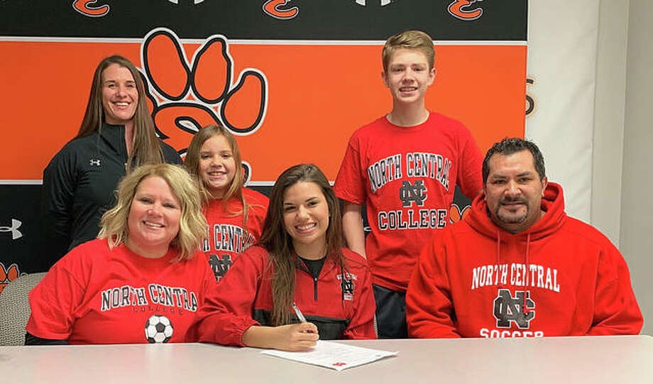 Edwardsville senior Ava Walls, seated center, will play college soccer at North Central College. She is joined by her family and EHS coach Abby Federmann. Photo: Matt Kamp/Intelligencer