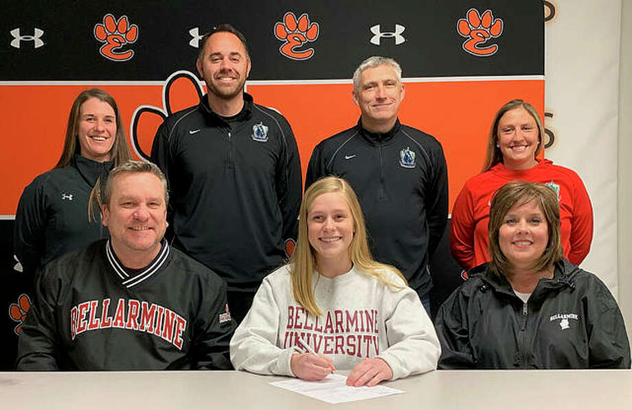 Edwardsville senior Sarah Kraus, seated center, will play soccer at Bellarmine University in Louisville. She is joined by her parents and EHS coach Abby Federmann. Photo: Matt Kamp/Intelligencer