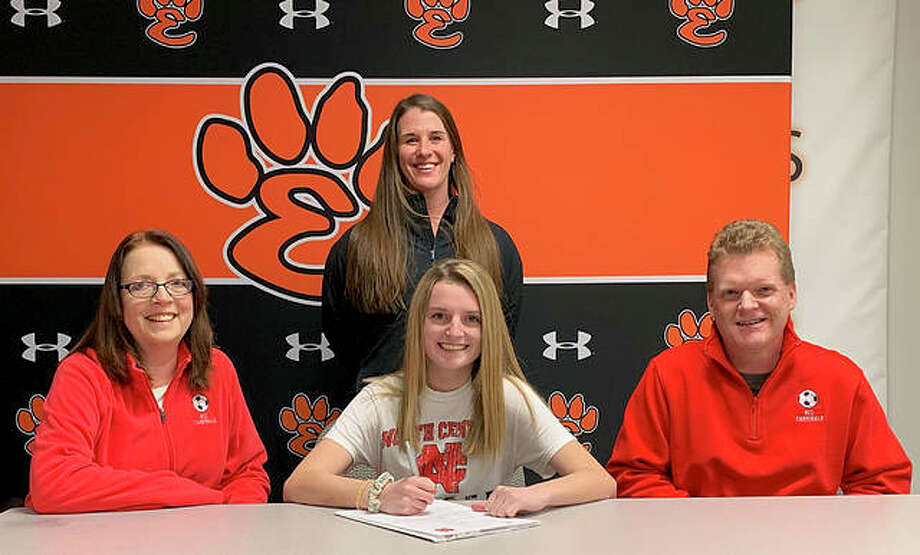 Edwardsville senior Libby Doak, seated center, will play women's soccer at North Central College in Naperville. She is joined by her parents and EHS coach Abby Federmann. Photo: Matt Kamp/Intelligencer