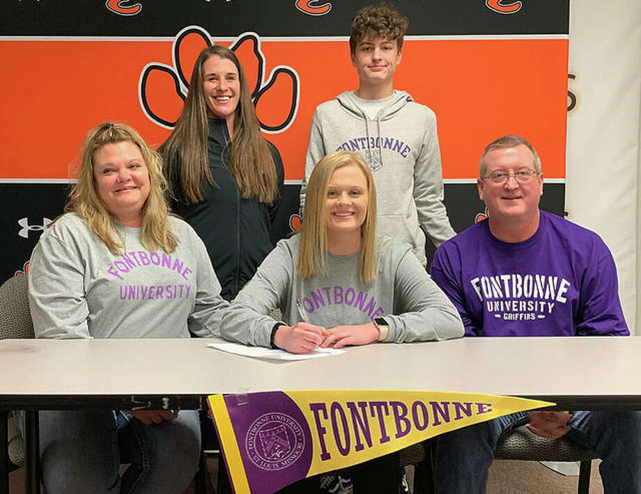 EHS senior Libby Bateman, seated center, will play college soccer at Fontbonne University. She is joined by her family and EHS coach Abby Federmann. Photo: Matt Kamp/Intelligencer
