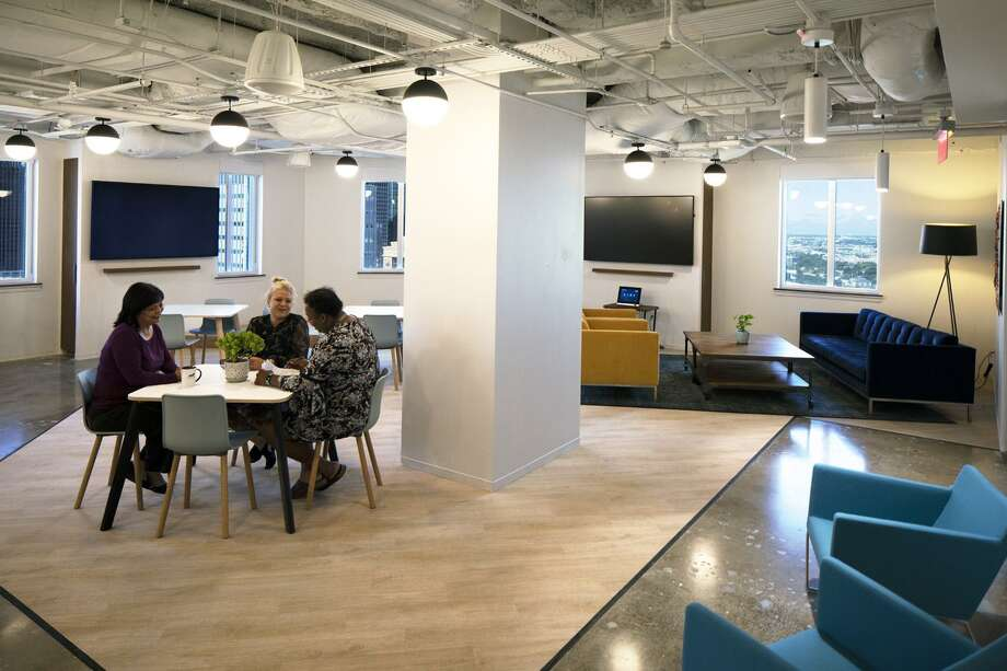 "Lionstone Investments incorporated a multipurpose room called the ""Den"" at its new offices in 712 Main. It can accommodate the entire firm for monthly meetings and special events. The space includes kitchen amenities, ample seating, a stage with lighting and large-scale video screens. Photo: Lionstone Investments"