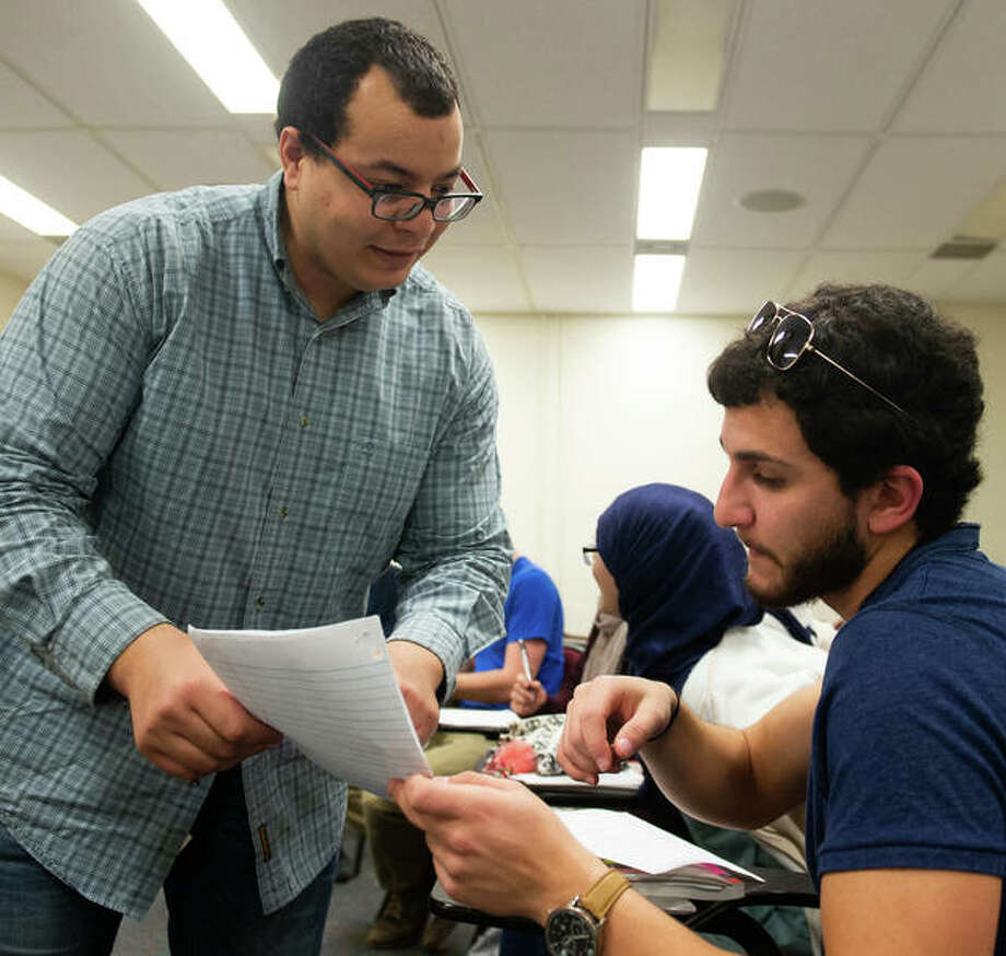SIUE Visiting Fulbright Scholar Wajdi Balloumi, of Tunisia, works with an SIUE student. Photo: For The Telegraph