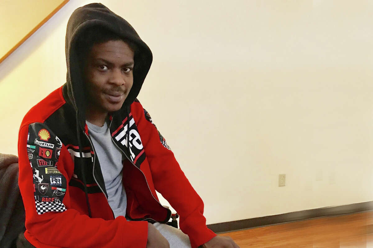 Ellazar Williams, shot by police in August and paralyzed as a result of the incident, in shown in his North Albany apartment on Jan. 27, 2019. He is using a wheelchair more regularly now and moved to a ground-level apartment so he can go outside. He insisted on wearing a hoodie over his head because he said he was having a bad hair day and his hair was not neatly braided. (Paul Grondahl/Times Union)