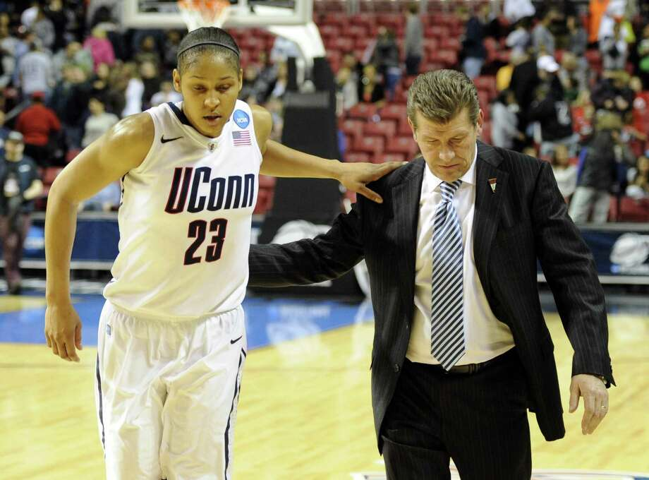 Maya Moore (23) walks off the court with head coach Geno Auriemma after defeating Georgetown 68-63 on March 27, 2011. Photo: Barbara Johnston / AP / AP2011