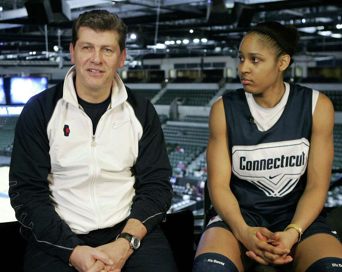 Maya Moore, right, looks on as UConn coach Gino Auriemma speaks during an interview at the women's NCAA college basketball Trenton Regional in Trenton, N.J. on Saturday, April 4, 2009.