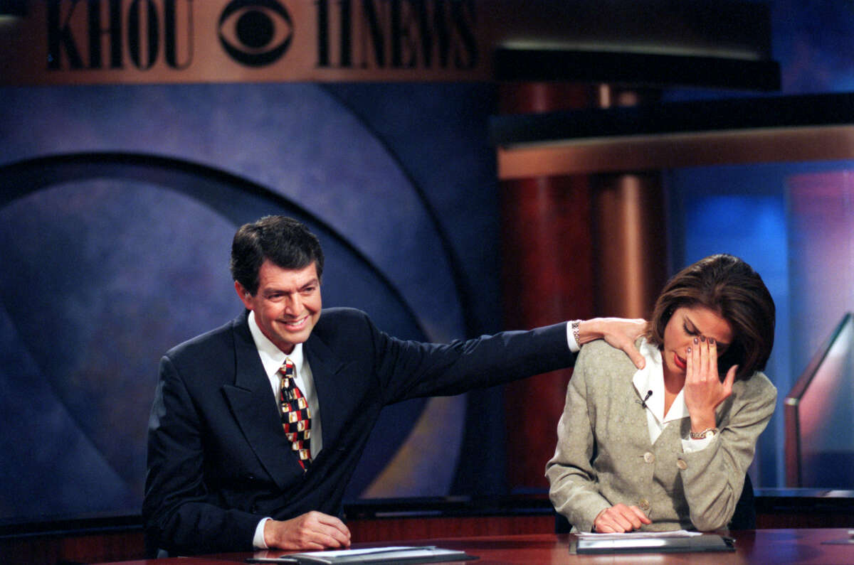 News anchor Sylvan Rodriguez comforts co-anchor Lisa Foronda after telling viewers he has cancer and would be leaving the station for several months of treatment in 1999.