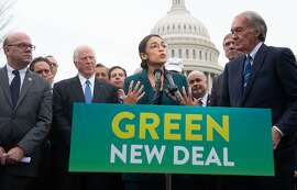US Representative Alexandria Ocasio-Cortez, Democrat of New York, and US Senator Ed Markey (R), Democrat of Massachusetts, speak during a press conference to announce Green New Deal legislation to promote clean energy programs outside the US Capitol in Washington, DC, February 7, 2019. (Photo by SAUL LOEB / AFP)SAUL LOEB/AFP/Getty Images