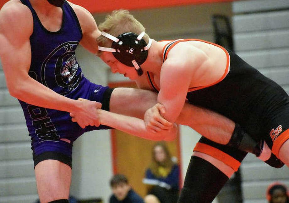 Edwardsville's Noah Surtin wrestles in the 120-pound championship match of the Class 3A Granite City Regional. Photo: Matt Kamp/Intelligencer