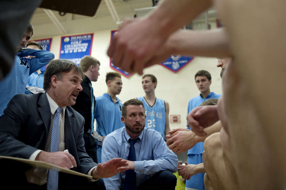 Meridian coach Mitch Bohn talks with his team between quarters of a Class C district final vs. Ithaca on March 11, 2016. Photo: Daily News File Photo