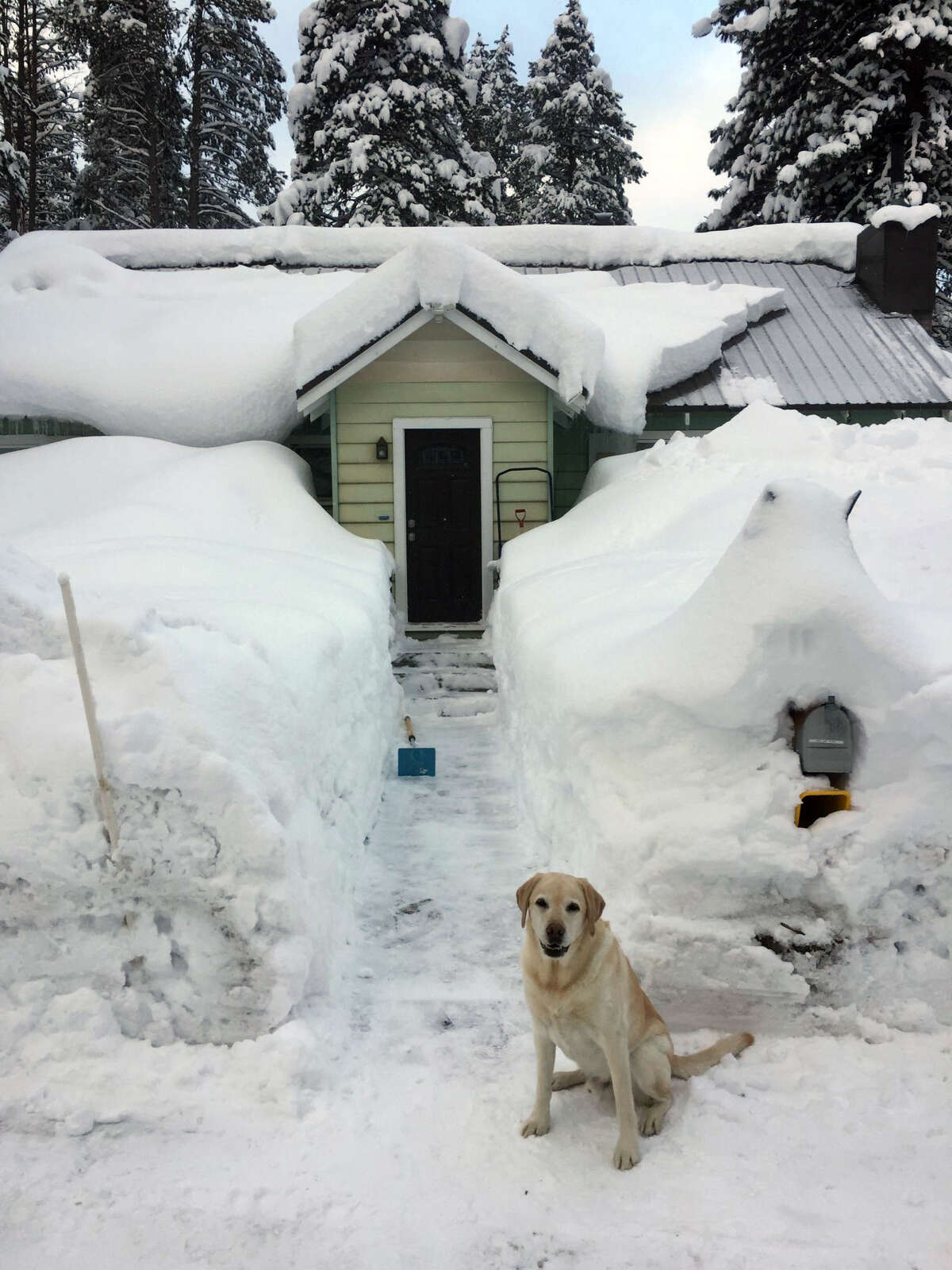 Snow piled high at a house in the high country of Truckee, Calif., on Feb. 6, 2019.