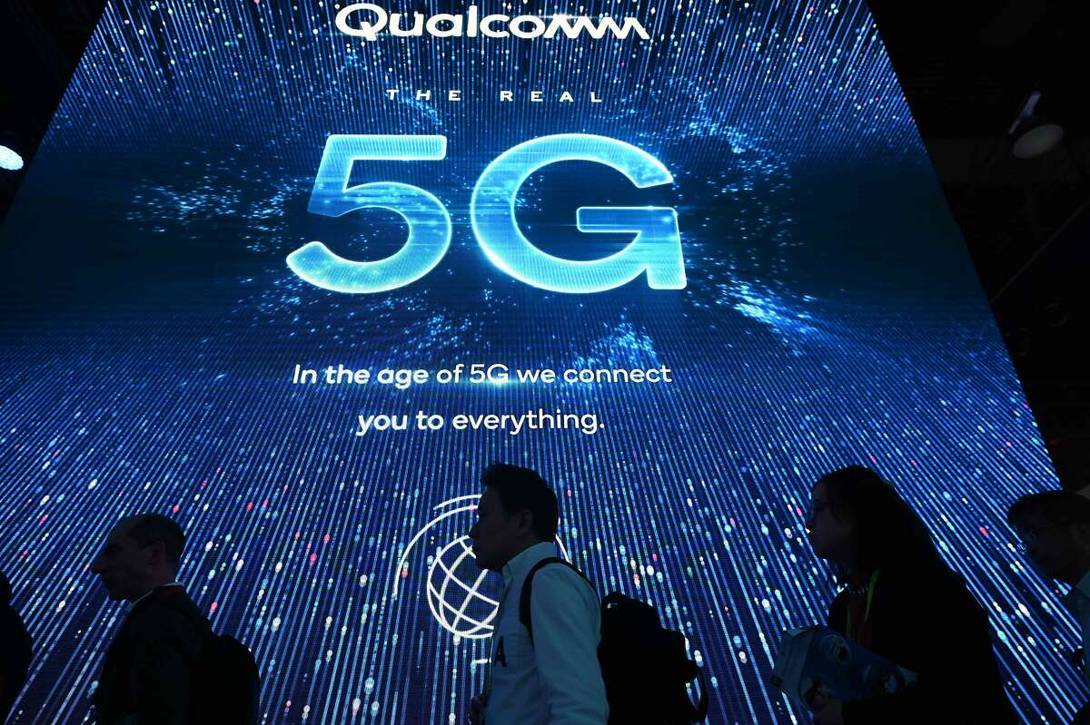 Attendees wait in line for a 5G exhibition at the Qualcomm booth during CES 2019 consumer electronics show, on January 10, 2019 at the Las Vegas Convention Center in Las Vegas, Nevada. (Photo by Robyn Beck / AFP)ROBYN BECK/AFP/Getty Images