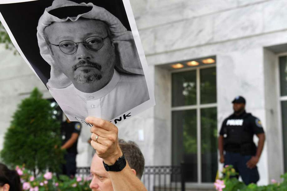 Michael Beer holds a poster during a rally about the disappearance of Washington Post journalist Jamal Khashoggi outside the Embassy of Saudi Arabia on Oct. 10, 2018, in Washington. Photo: Washington Post Photo By Matt McClain. / The Washington Post