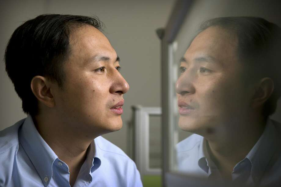 FILE - In this Oct. 10, 2018, file photo, He Jiankui is reflected in a glass panel as he works at a computer at a laboratory in Shenzhen in southern China's Guangdong province. A Chinese investigation says Chinese scientist He, behind the reported birth of two babies whose genes had been edited in hopes of making them resistant to the AIDS virus, acted on his own and will be punished for any violations of the law. (AP Photo/Mark Schiefelbein, File) Photo: Mark Schiefelbein, Associated Press