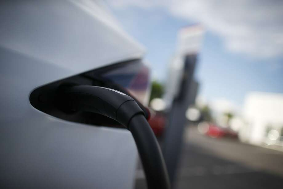 FILE- In this May 27, 2018, photo a 2018 Model X is plugged into a charging station at a Tesla dealership in Littleton, Colo. Cold temperatures can sap electric car batteries, temporarily reducing their range by more than 40 percent when interior heaters are used, a new study found. The study of five electric vehicles by AAA also found that high temperatures can cut into battery range, but not nearly as much as the cold. The range returns to normal in more comfortable temperatures. (AP Photo/David Zalubowski, File) Photo: David Zalubowski, Associated Press