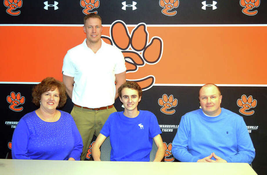 Edwardsville senior Parker Griffiths, seated center, signed to play golf at Lewis and Clark Community College. He is joined by his parents and EHS coach Adam Tyler. Photo: Scott Marion/Intelligencer