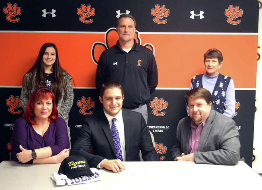Edwardsville senior Josh Anderson, seated center, will play college football for Olivet Nazarene. He is joined by his family and EHS coach Matt Martin. Photo: Scott Marion/Intelligencer