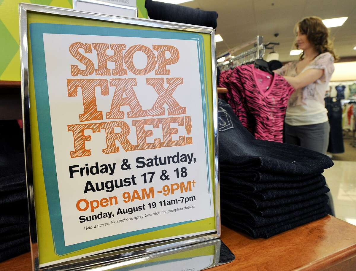 Sales associate Kynda Bradshaw straightens a rack of clothing Tuesday, Aug. 14, 2012, near a sign advertising the Tax-Free Weekend, Friday and Saturday, Aug. 17-18, 2012, at the Bealls Department Store in Nacogdoches, Texas. Tax-Free Weekend gives a break on state and local sales tax on included clothing and school supplies in time for back-to-school shopping. (AP Photo/The Daily Sentinel, Andrew D. Brosig) MANDATORY CREDIT
