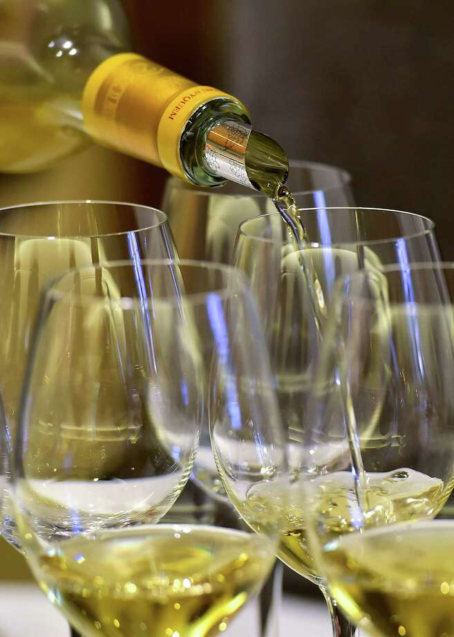 """A person serves some Chateau d'Yquem wine during a tasting at the Chateau d'Yquem in Sauternes, southwestern France, on January 28, 2019. - Chateau d'Yquem is the only """"Premier Cru Superieur"""" wine in the Sauternes region located southern part of the Bordeaux vineyards known as Graves. (Photo by GEORGES GOBET / AFP)GEORGES GOBET/AFP/Getty Images Photo: GEORGES GOBET, Contributor / AFP/Getty Images / AFP or licensors"""