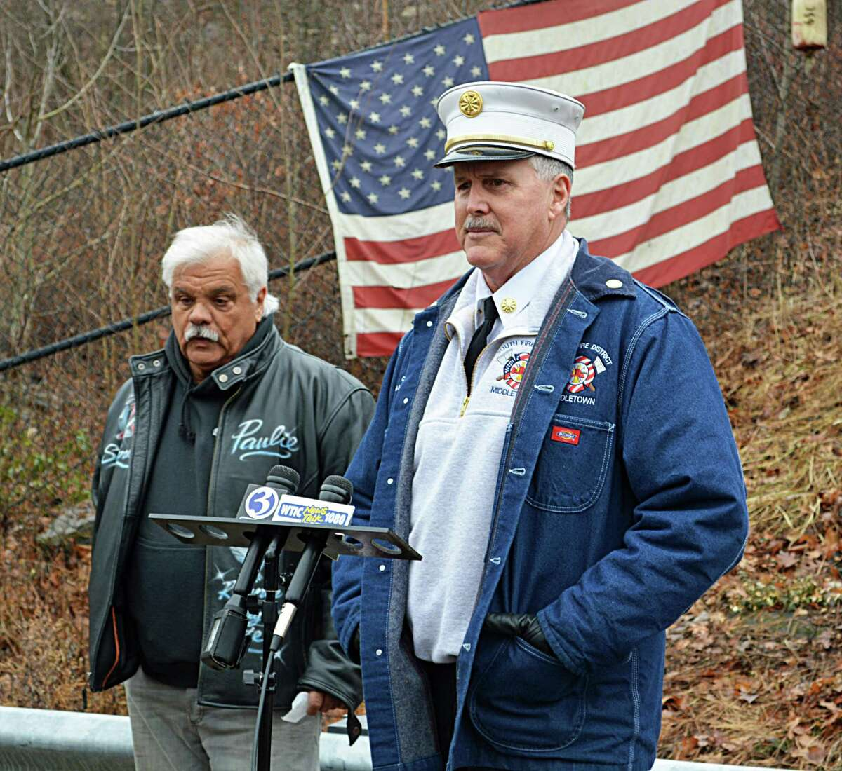 Union workers, officials, and families and friends of the Kleen Energy blast victims gathered Thursday morning at the memorial on River Road in Middletown to remember the six men who died Feb. 7, 2010, in the tragic gas explosion. Here, South Fire District Chief Michael Howley, right, and event organizer and former plant worker Paul Venti, left, speak to those in attendance.