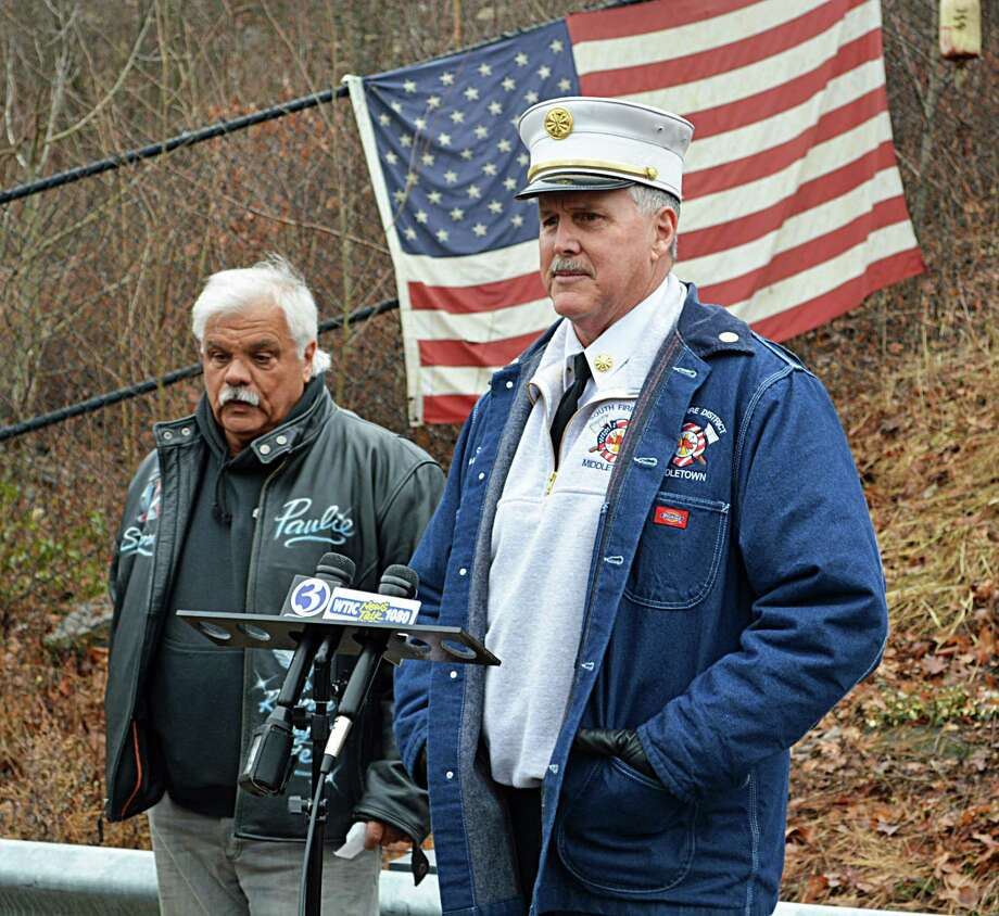 Union workers, officials, and families and friends of the Kleen Energy blast victims gathered Thursday morning at the memorial on River Road in Middletown to remember the six men who died Feb. 7, 2010, in the tragic gas explosion. Here, South Fire District Chief Michael Howley, right, and event organizer and former plant worker Paul Venti, left, speak to those in attendance. Photo: Cassandra Day / Hearst Connecticut Media