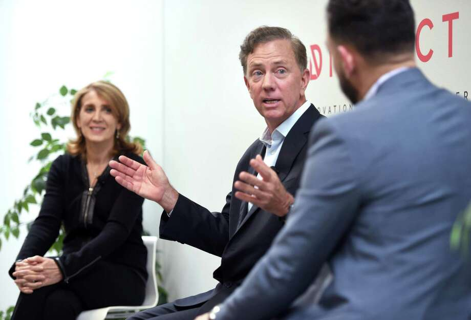 While on the campaign trail in September 2018 in advance of his election, Gov. Ned Lamont discusses innovation in Connecticut alongside Ruth Porat, chief financial officer of Google and parent Alphabet; and David Salinas, co-founder of the District Innovation and Venture Center in New Haven. Photo: Arnold Gold / Hearst Connecticut Media / New Haven Register