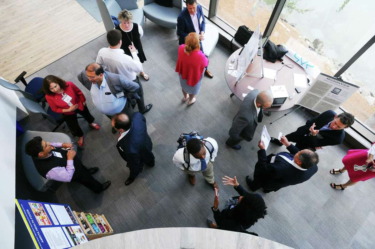 Investors and entrepreneurs network during an event at Workpoint in the Shippan neighborhood of Stamford, Conn. on Thursday, June 8, 2017.