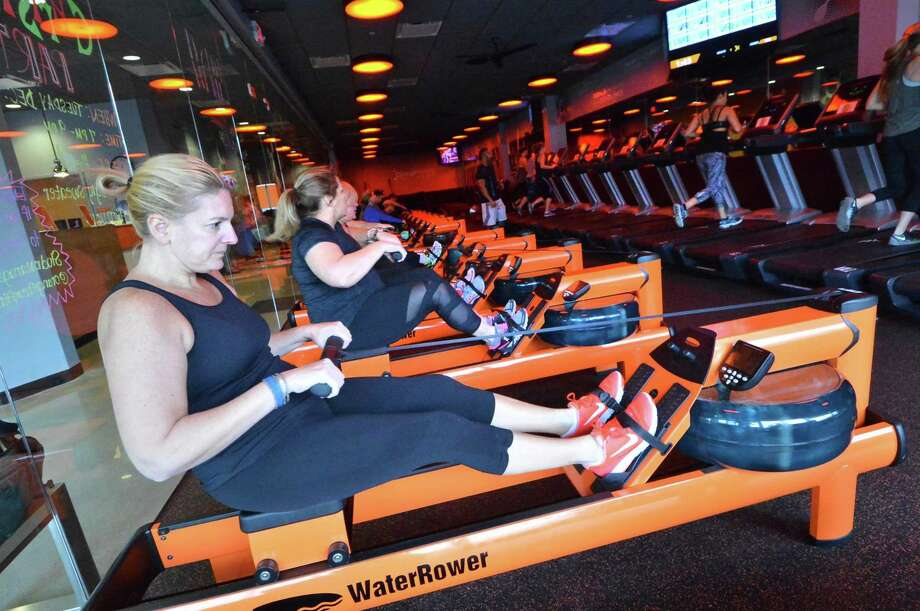 Debra Clark works out on a Water Rower, part of an endurance fitness training class at Orangetheory Fitness in December 2016 in Norwalk. Photo: Alex Von Kleydorff / Hearst Connecticut Media / Connecticut Post