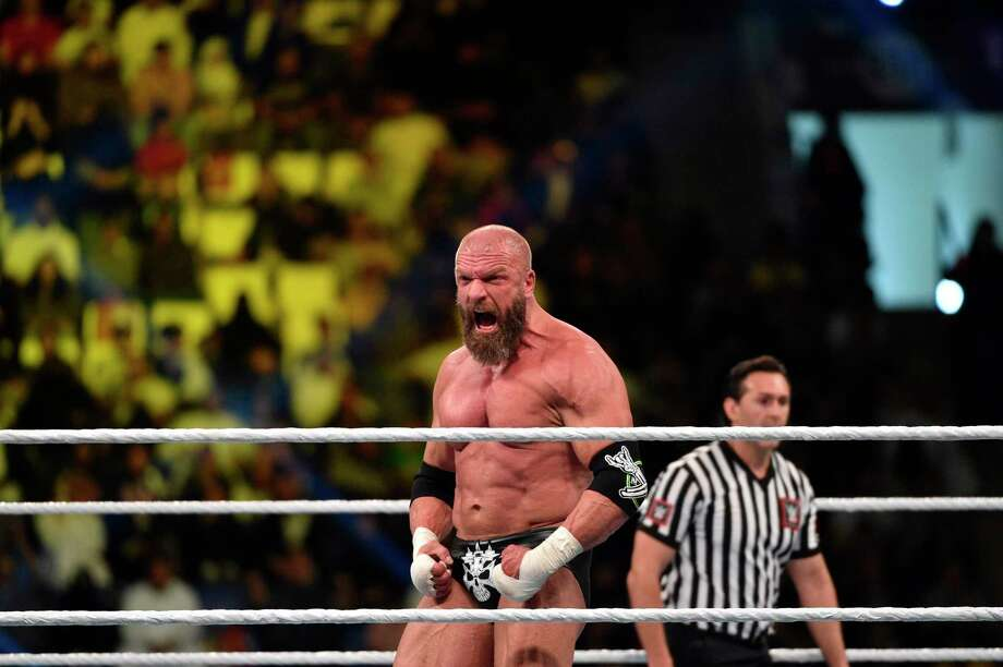 Triple H reacts during a tag team match as part of as part of the WWE Crown Jewel event at the King Saud University Stadium in Riyadh on November 2, 2018. Photo: FAYEZ NURELDINE / AFP /Getty Images / AFP or licensors