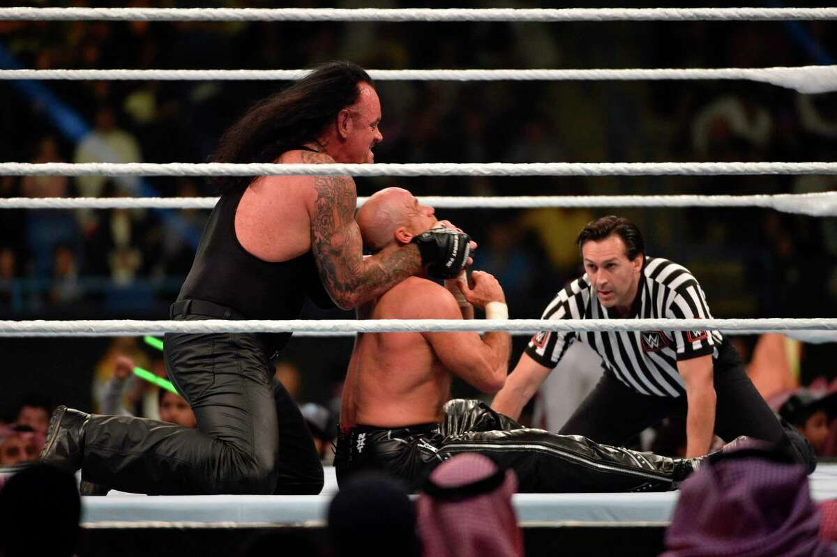 The Undertaker vies with Shawn Michaels during a tag team match as part of as part of the World Wrestling Entertainment (WWE) Crown Jewel pay-per-view at the King Saud University Stadium in Riyadh on November 2, 2018. So far, none of WWE's events in Saudi Arabia have featured women Superstars.