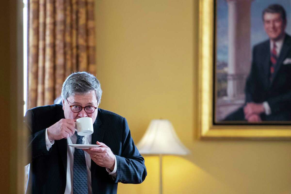 Attorney general nominee William Barr sips coffee in the office of Senate Majority Leader Mitch McConnell at the Capitol on Jan. 10, 2019.