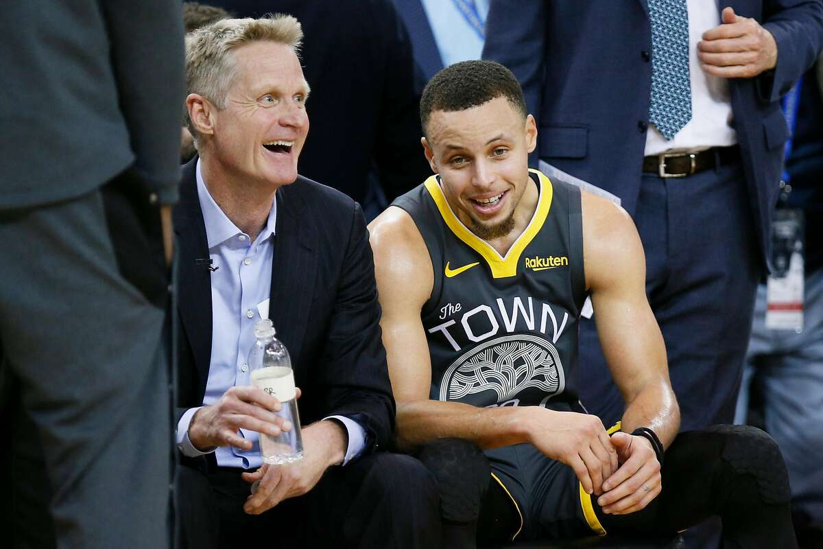 Golden State Warriors head coach Steve Kerr with Golden State Warriors guard Stephen Curry (30) in the second half of an NBA game against the Los Angeles Lakers at Oracle Arena on Saturday, Feb. 2, 2019, in Oakland, Calif. The Warriors won 115-101.