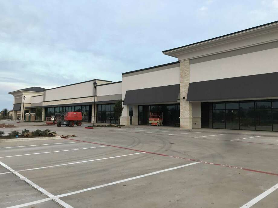 Riverstone Place Shopping Center will welcome Pacific Dental, Starbucks and Supercuts when it opens in spring 2019. Wulfe & Co. developed the 28,000-square-foot center at the southeast corner of University Boulevard and LJ Parkway in Sugar Land. Photo: Wulfe & Co.