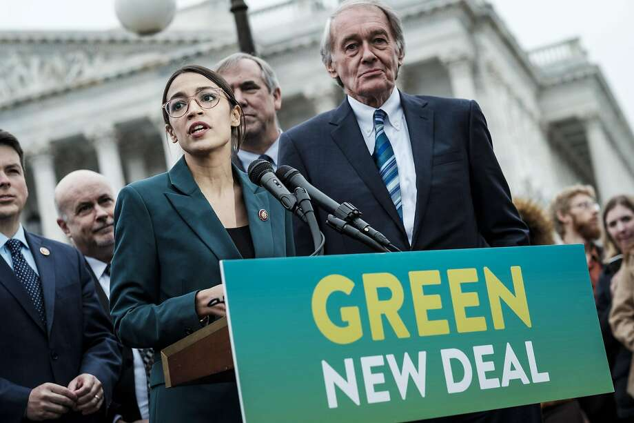 Rep. Alexandria Ocasio-Cortez (D-N.Y.) speaks alongside Sen. Ed Markey (D-Mass.) at a news conference about the Green New Deal, in Washington, Feb. 7, 2019. The measure, drafted by Ocasio-Cortez and Markey, calls for a sweeping environmental and economic mobilization that would make the United States carbon neutral by 2030. (Pete Marovich/The New York Times) Photo: Pete Marovich, NYT